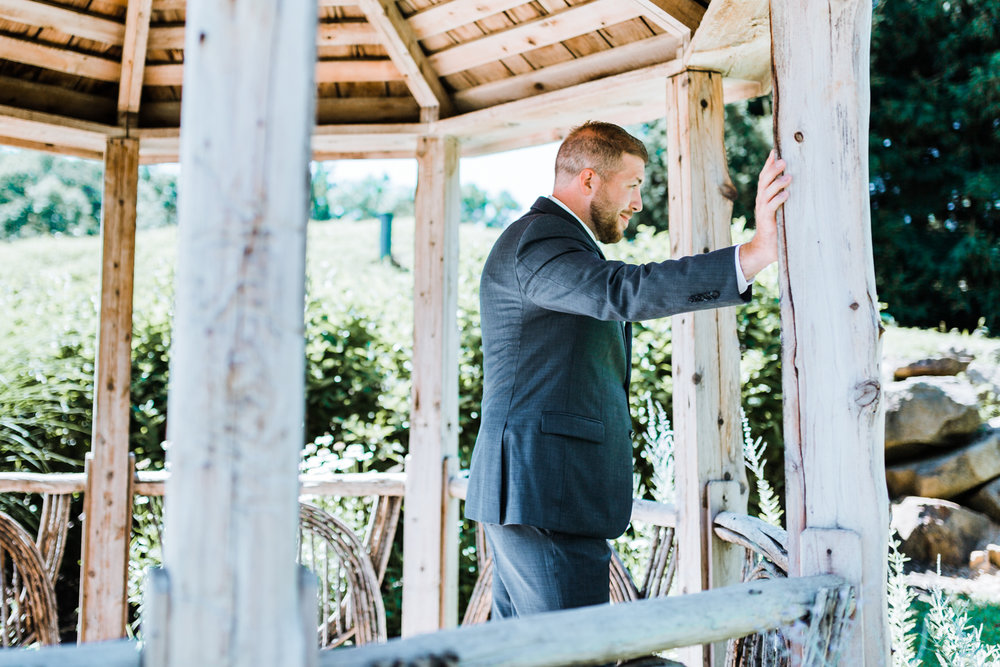 groom waiting for his bride for first look - top rated maryland and pa wedding photographer and videographer