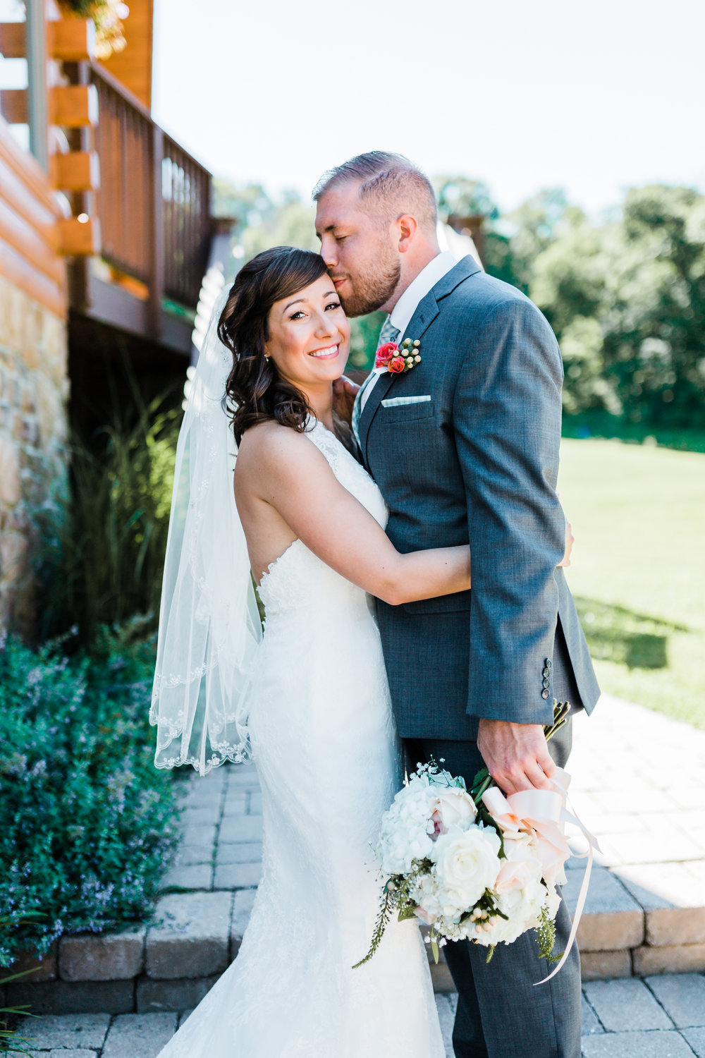 groom kissing his bride's temple gently - maryland wedding photo and video - PA wedding venues - mountain wedding inspo