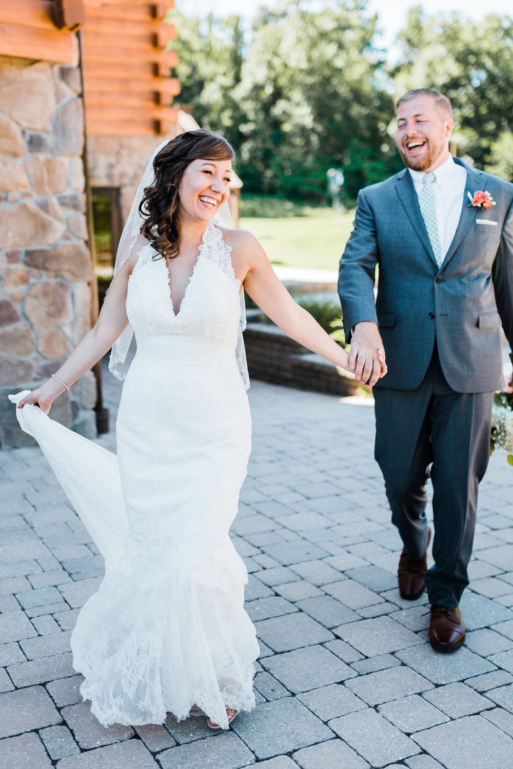 bride and groom running and laughing together - adventurous weddings - mountain wedding inspo