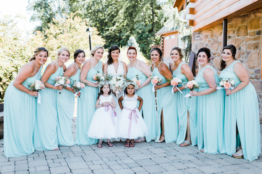 bride smiling with her bridesmaids and flowergirls - mint peach and gray wedding ideas - PA wedding venues - Liberty Mountain Resort