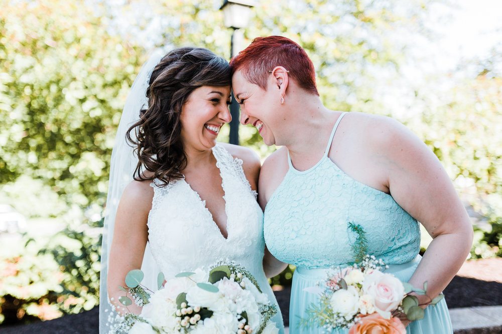 bride and her sister share a sweet moment - Liberty Mountain Resort weddings