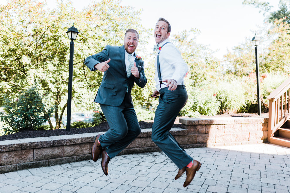 groom and groomsman jumping for fun - fun and exciting wedding photographer in Maryland Pennsylvania and DMV area