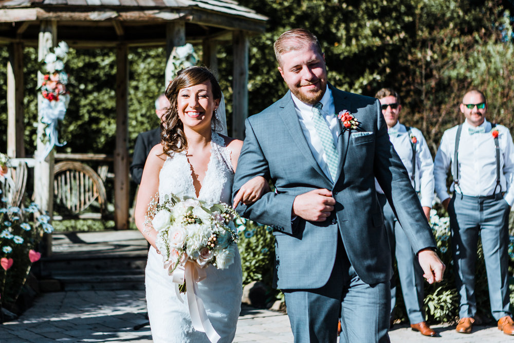 bride and groom happily walking down the aisle after saying I Do - Maryland wedding photographer