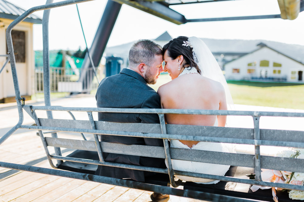 bride and groom portraits on the ski lift at Liberty Mountain Resort - unique wedding photography