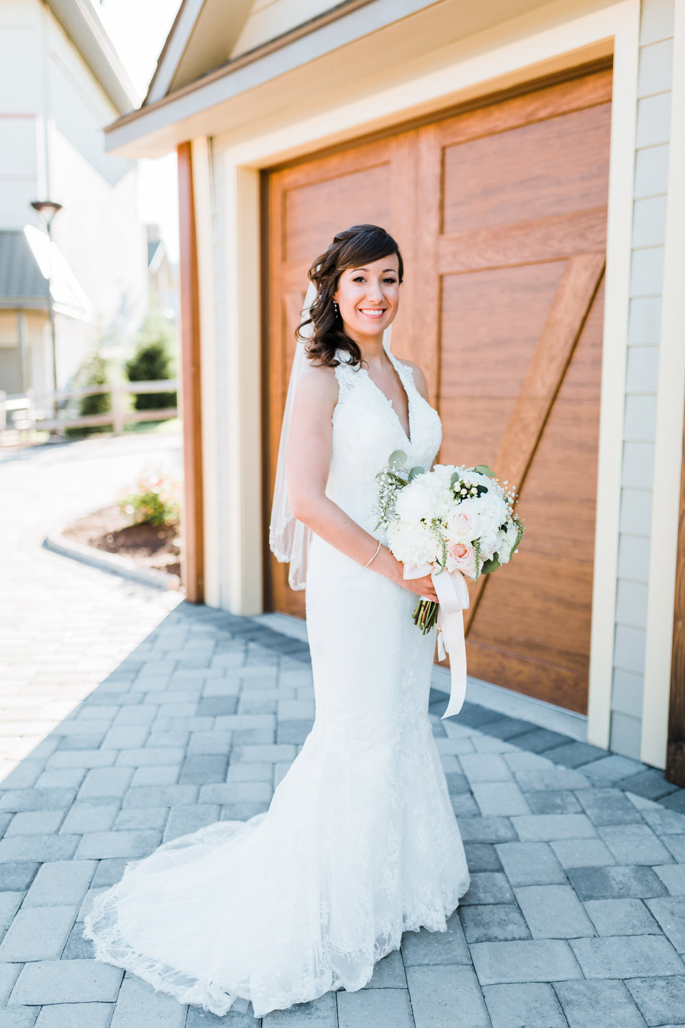 beautiful bride Tarah in front of gorgeous wooded doors - Liberty Mountain Resort wedding
