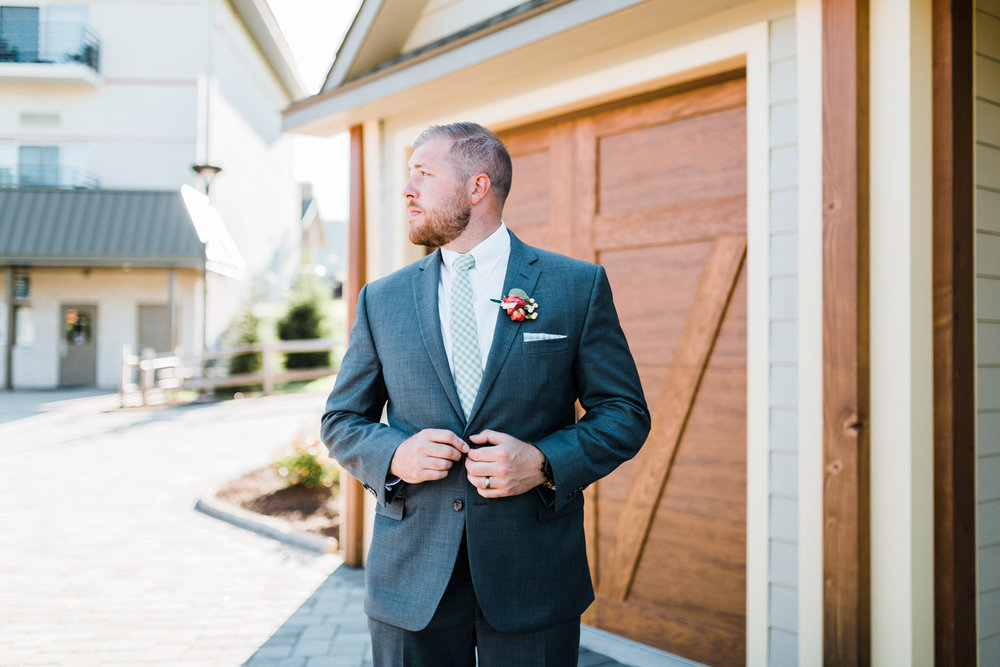handsome groom Eric in his gray suit with mint tie - best MD wedding videographer and photographer