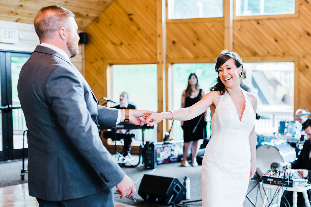 bride and groom having fun together during their first dance - ski liberty wedding