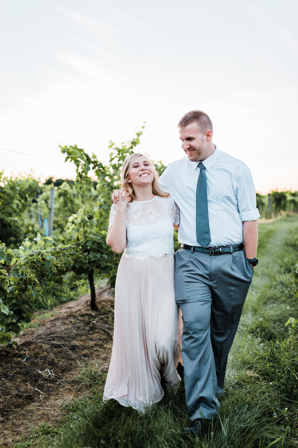 bride and groom walking and laughing during their engagement session - best md wedding photographer