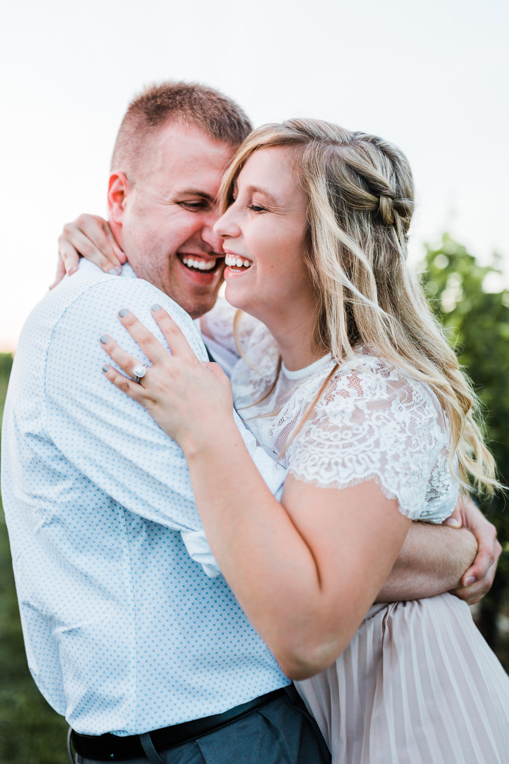 couple laughing together while hugging - maryland engagement photographer