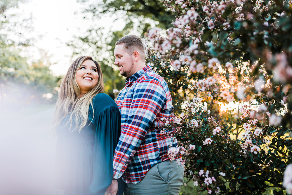 couple poses at golden hour at jonas green state park