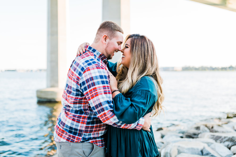 couple laughing together - annapolis engagement photographer
