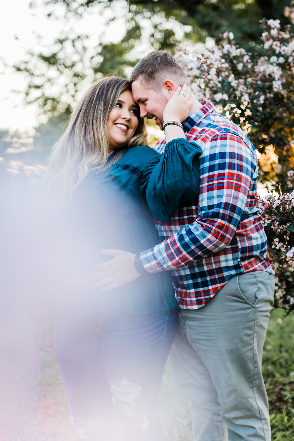 couple during engagement session with cherry blossom tree in annapolis md
