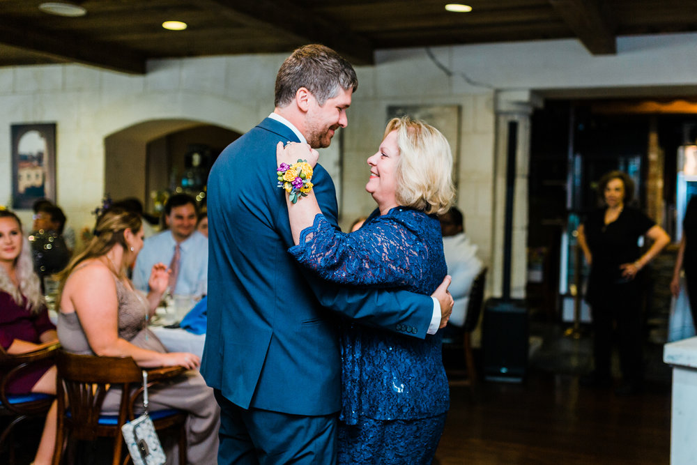 groom dances with his mother - top rated Maryland wedding photographer