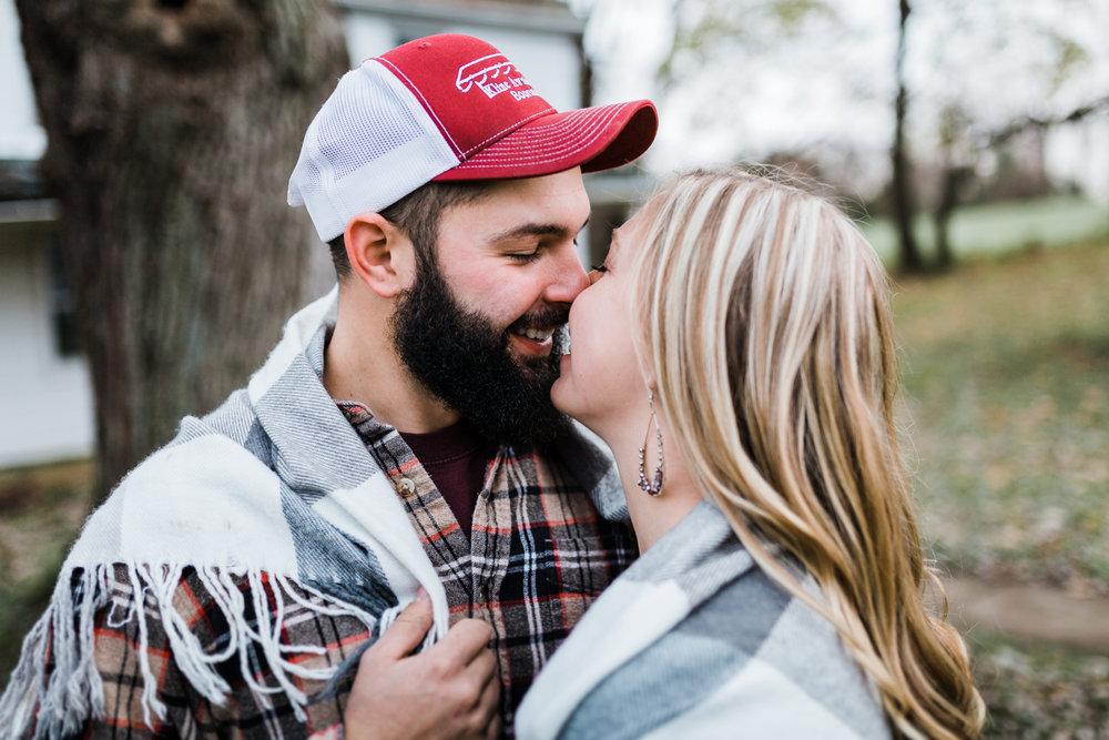 bride and groom snuggling in blanket together during their Frederick engagement session