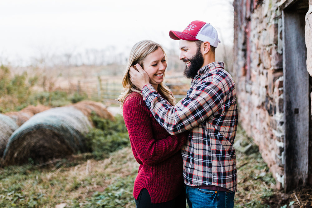 couple laughing together during engagement photos - best MD wedding photographer