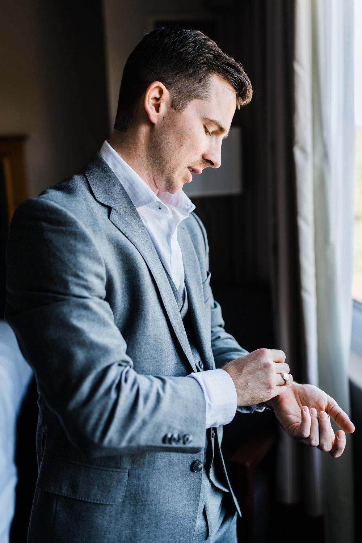 groom putting on his watch - Maryland wedding Photography
