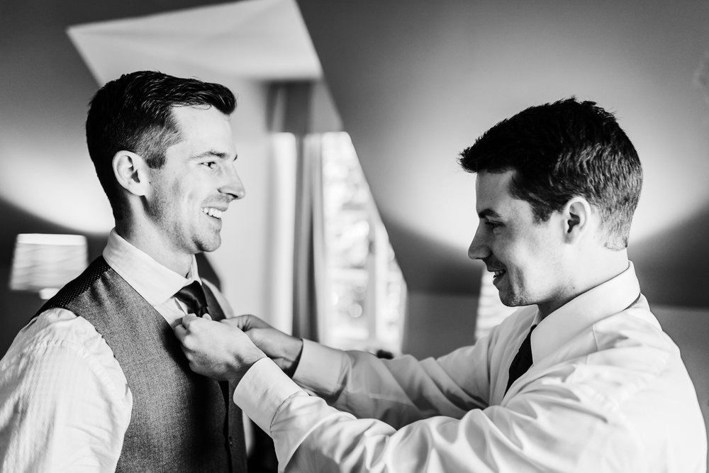 groom and his brother getting ready together - top rated Maryland wedding photographer