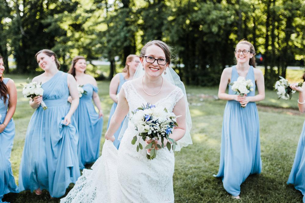 bride-smiling-blue-wedding-inspo.jpg