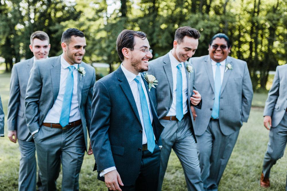 groom-laughing-with-groomsmen.jpg