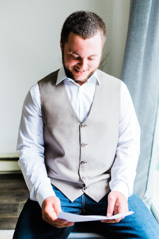 groom-reading-letter.jpg