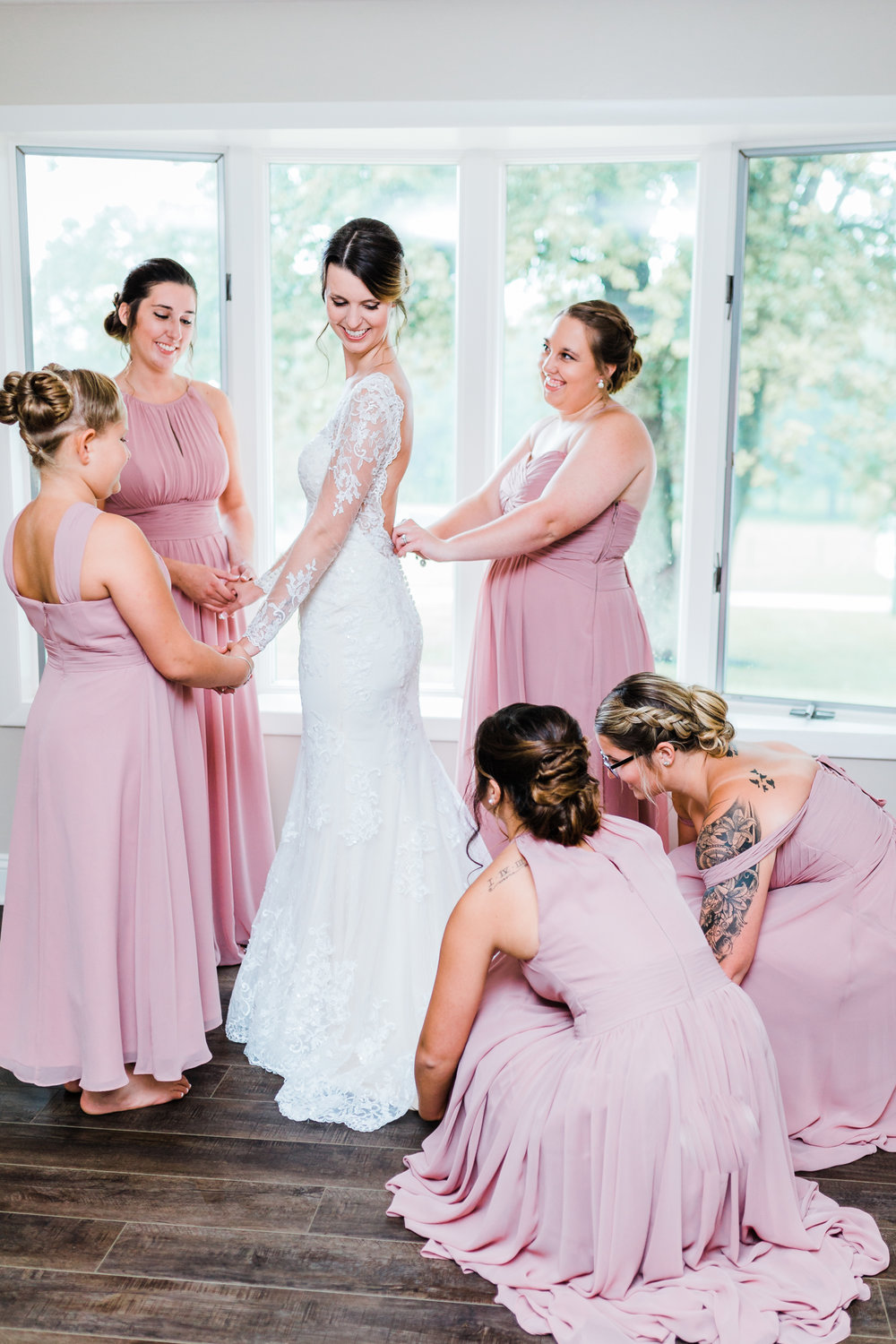 bride getting ready with her bridesmaids - cascade, maryland wedding