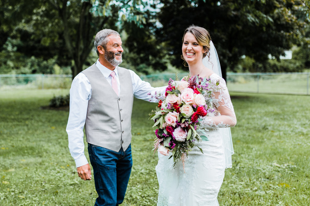 Maryland wedding photography and videography - bride and dad first look laughing