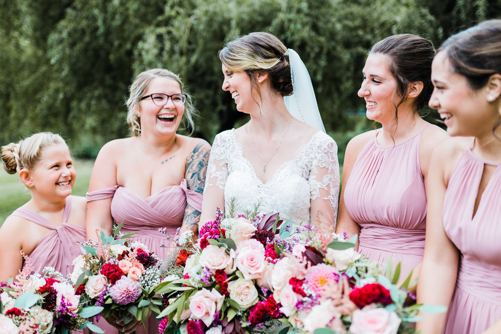bride laughing with her bridesmaids - pink wedding inspo