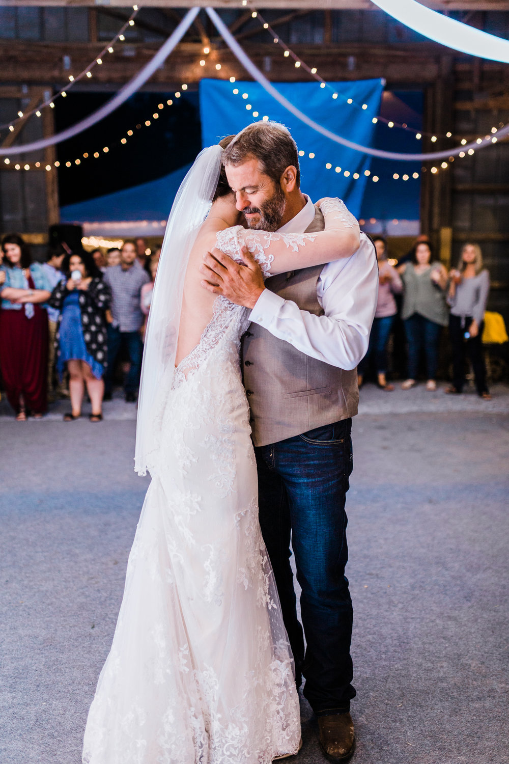 bride shares dance with her father