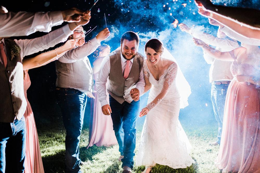 bride-groom-rainy-sparkler-exit.jpg