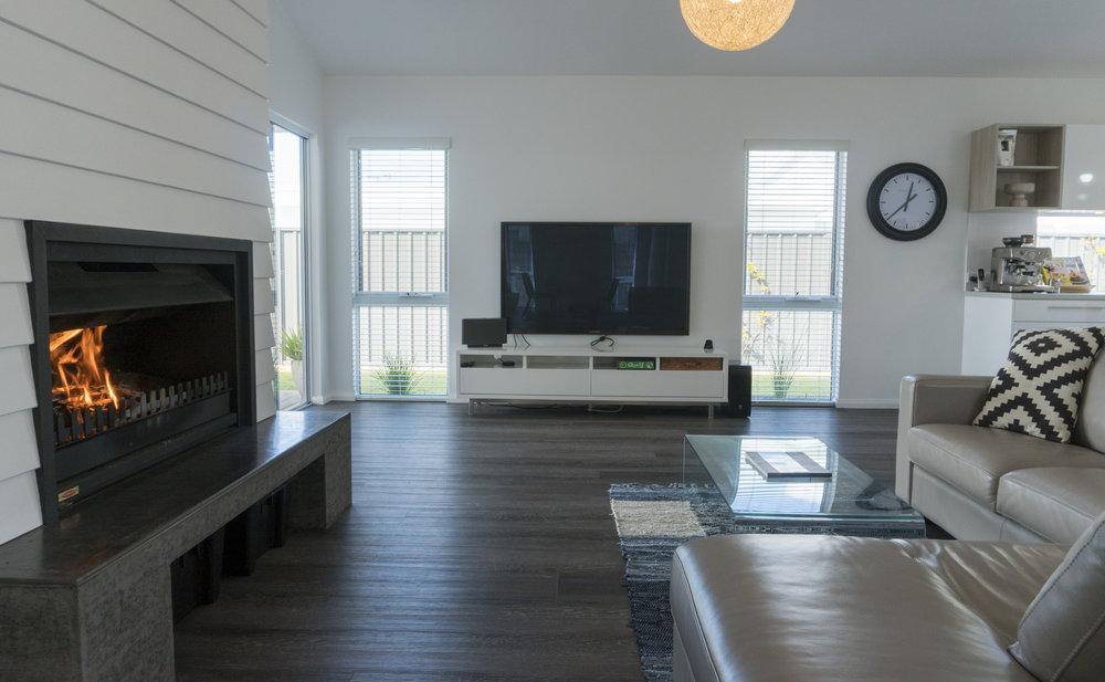 O&E LIVING ROOM WITH FIRE AND TV.jpg