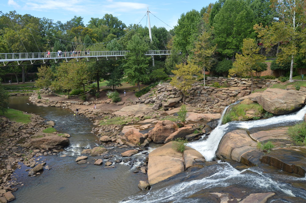- The falls on the Reedy River and the Liberty Bridge crossing over in front of them are the centerpiece of this very modern city proud to accentuate its natural beauty, southern charm and forward thinking.