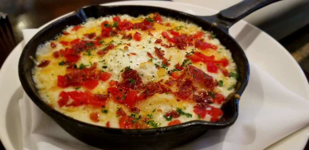 The Cast Iron Mac & Cheese at The Asbury  Restaurant in Charlotte is listed as a side, but truthfully you could order a couple of these and be satisfied for days.