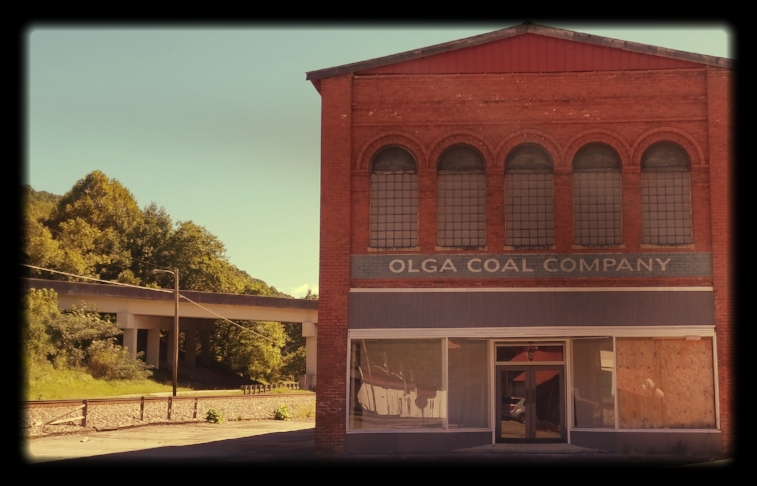 "The old H. Sienknecht Company Department Store still carries the ""Olga Coal Company"" logo from its role on the set of the movie ""October Sky."""