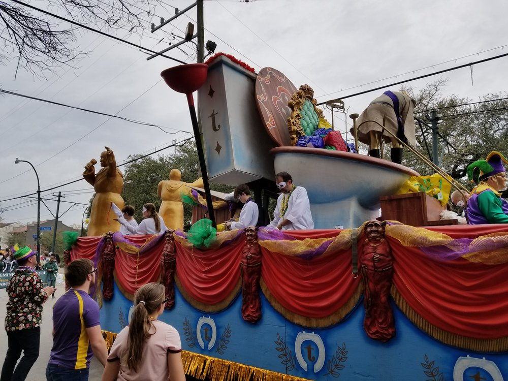 The Krewe of Tucks rolls through Uptown New Orleans throwing plungers, mini-toilets that shoot out water and plenty of Tucks toilet paper.