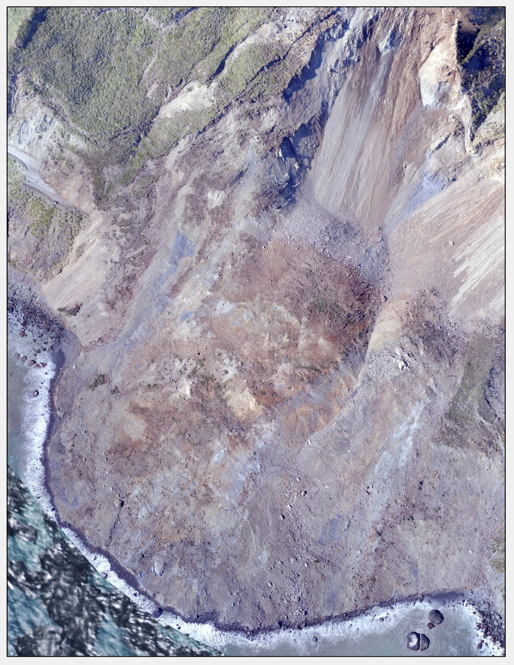 State Route 1 at Mud Creek, Monterey County, California, May 24th, 2017.      Major slope failure has occurred; approximately 2,230 feet of SR-1 is buried. No reconstruction work has begun as the landform is still undergoing settling motion.