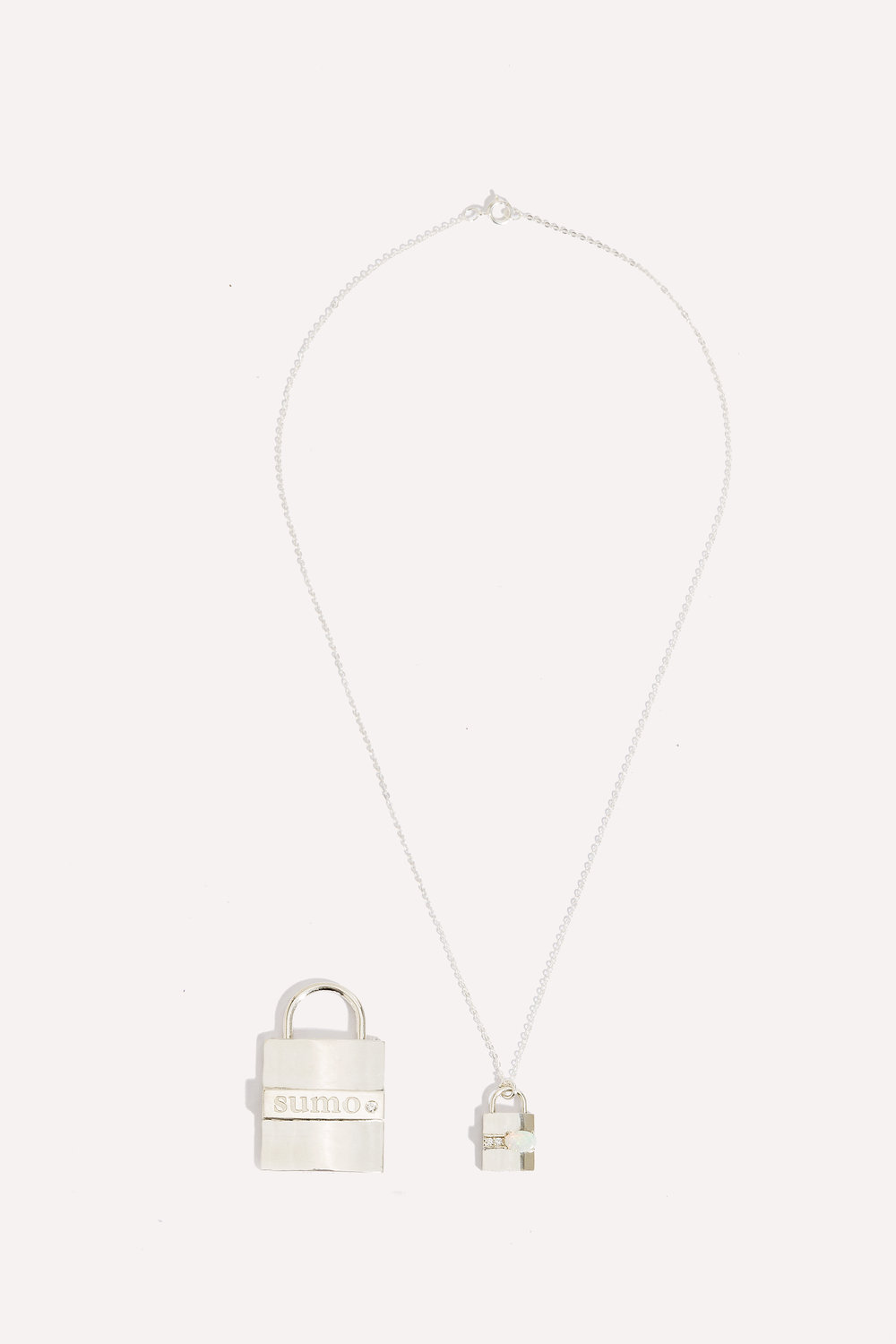 The Pet Tag comes in a variety of metals from brass to solid gold, with the option to add his or hers birthstone to it. The matching necklace comes in sterling silver or gold with pave diamonds and option to adjust your birthstone as well.