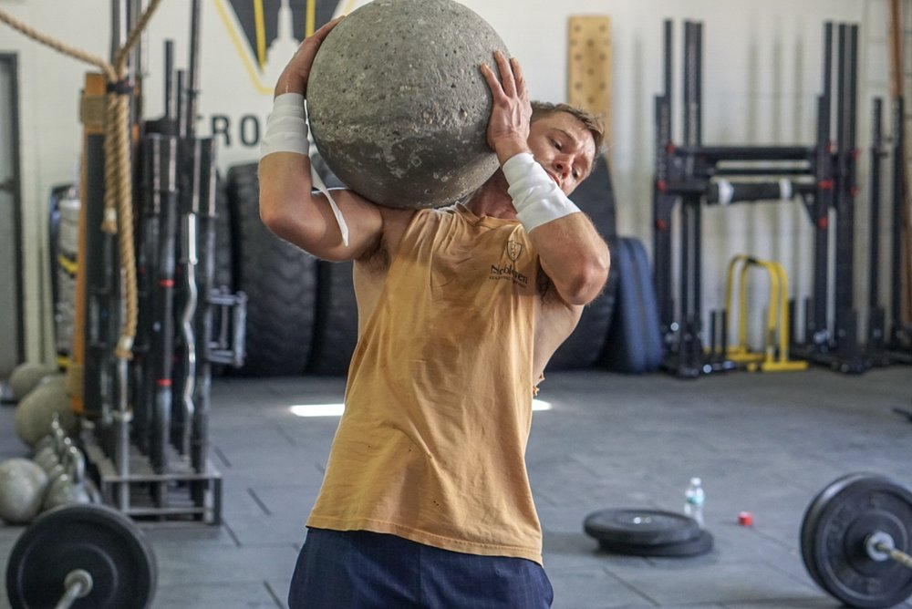 - 5-4-3-2-1-2-3-4-5Back Squatwith 50' Farmer Carry after each set