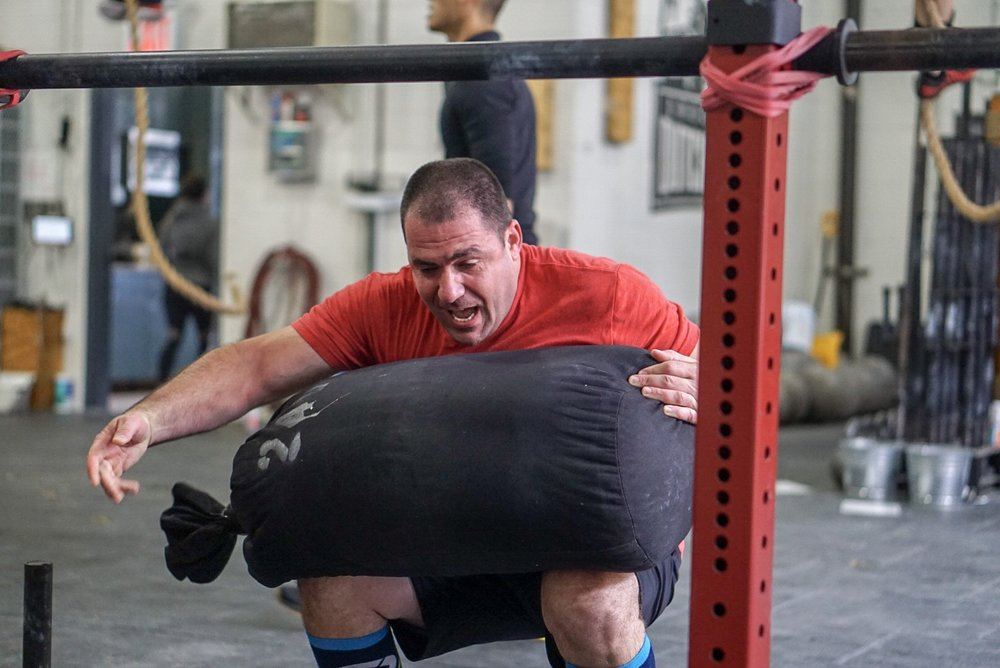 - For Time, complete;100 Hang Power Clean (135/95)*start with an 80' Sandbag Carry at body weight, continue to complete an 80' Sandbag Carry each time you break