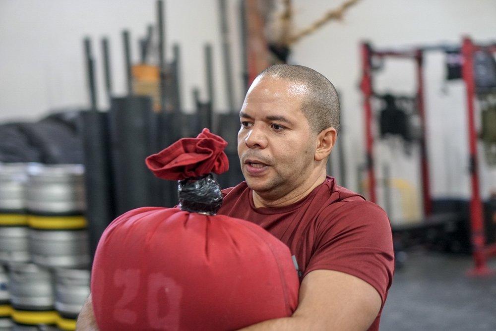 - 8 Rounds50' Sandbag Carry (bodyweight)15 Medball Sit-up50' Sandbag Carry5 Push Jerk (AHAP)
