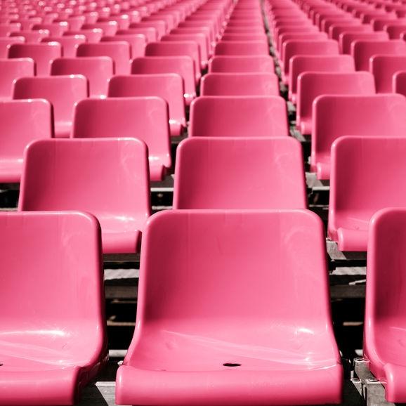 Stocksy Pink Seats in Arena.jpg
