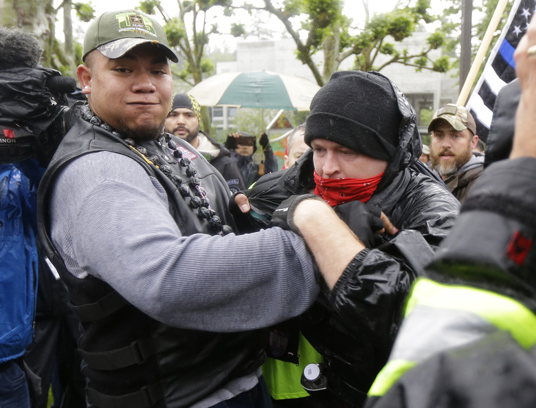 """The violent white attacker on the right is not, in fact, part of the Patriot Prayer. That would be Tusitala Toese, aka """"Tiny,"""" on the left."""