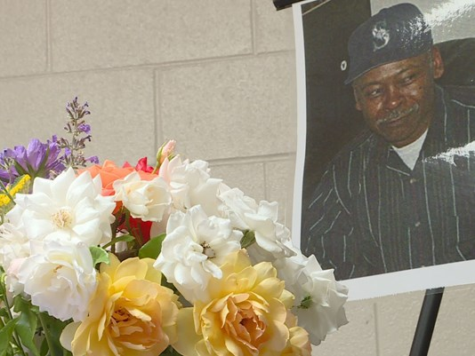 Flowers laid at a memorial for James Farmer Jr.