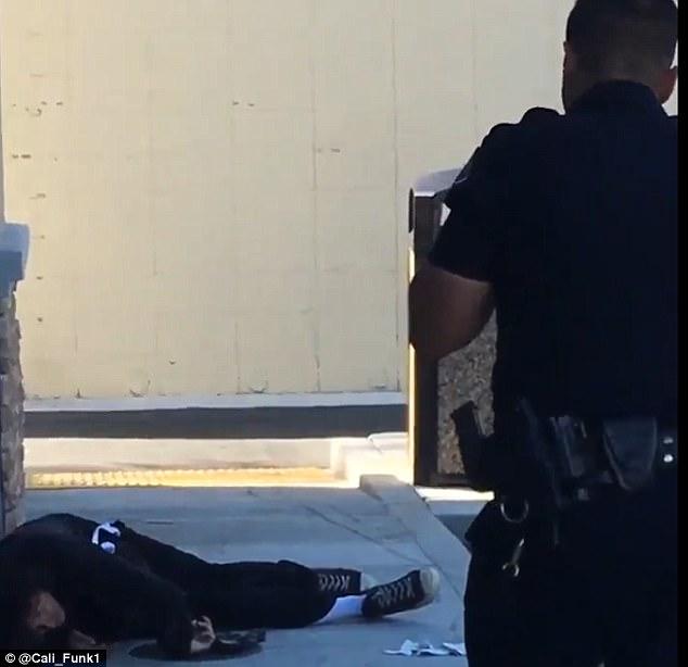 Magazine visible on officer's front-left side