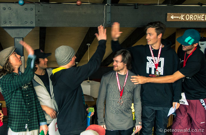 Tom, Jason Waters & Cam of the podium from 3rd to 1st repectively taking high fives from the rest of the top ranks of the ski men