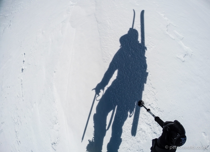 Walking slowly up the west ridge with ice axe and crampons