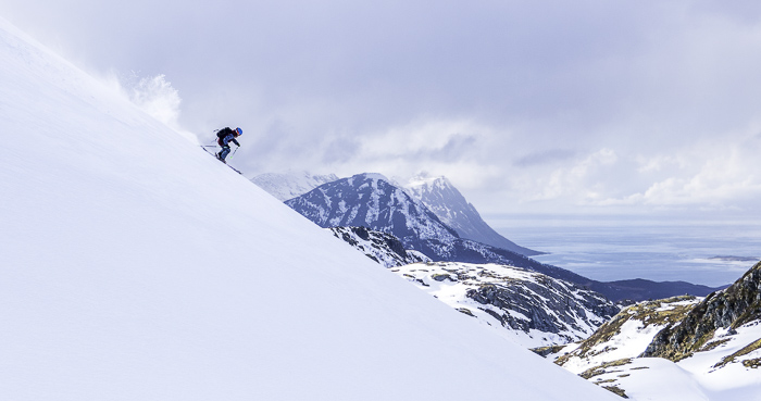Sophie shredding down an isolated ridge