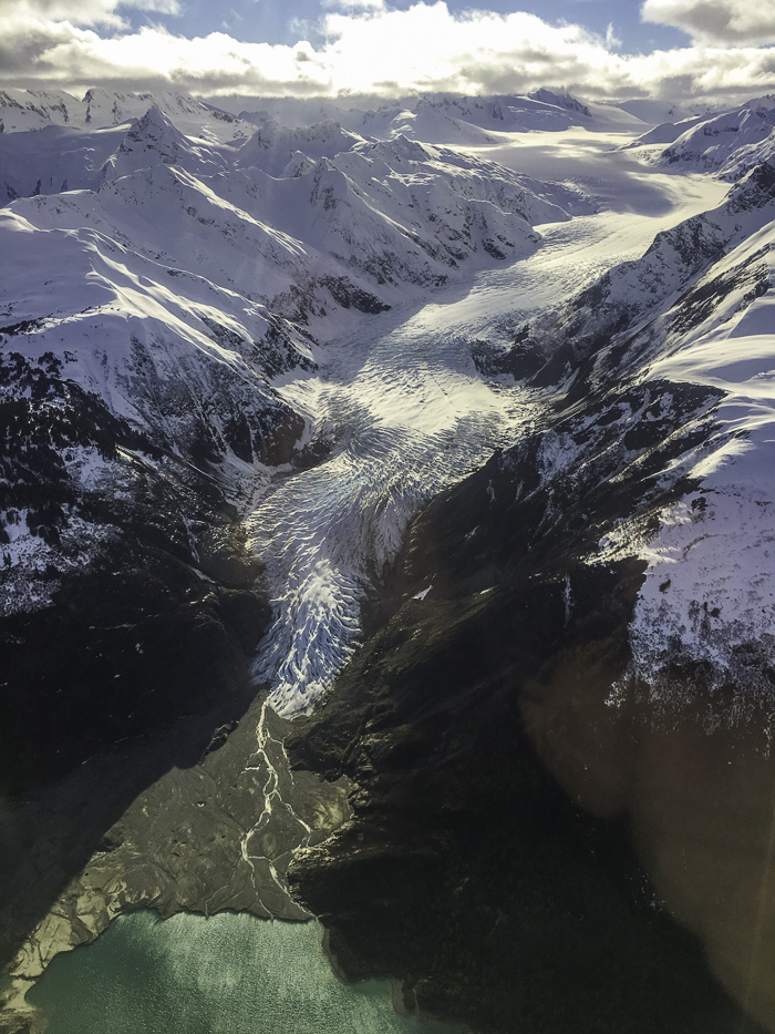 A view from the flight out of Haines of a massive glacier that terminates in the sea… or used to