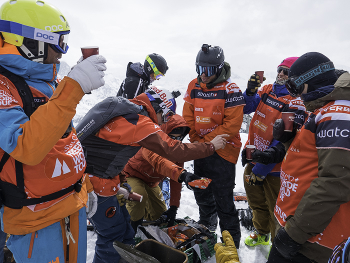 Ski men competitors getting hot refreshments while waiting for a weather window on the freezing summit that would never come