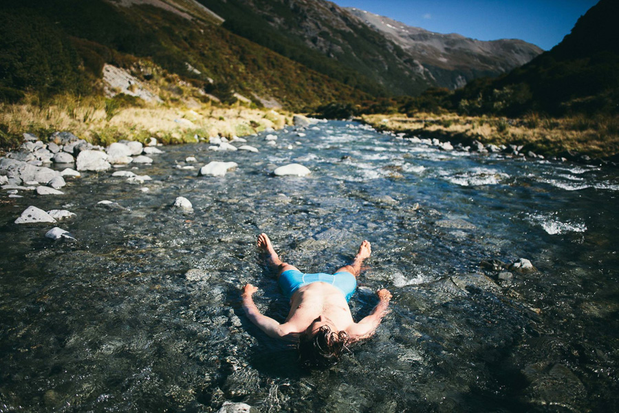 Pete cools down and washes off in the ice cold river. Photo: Tom Powell