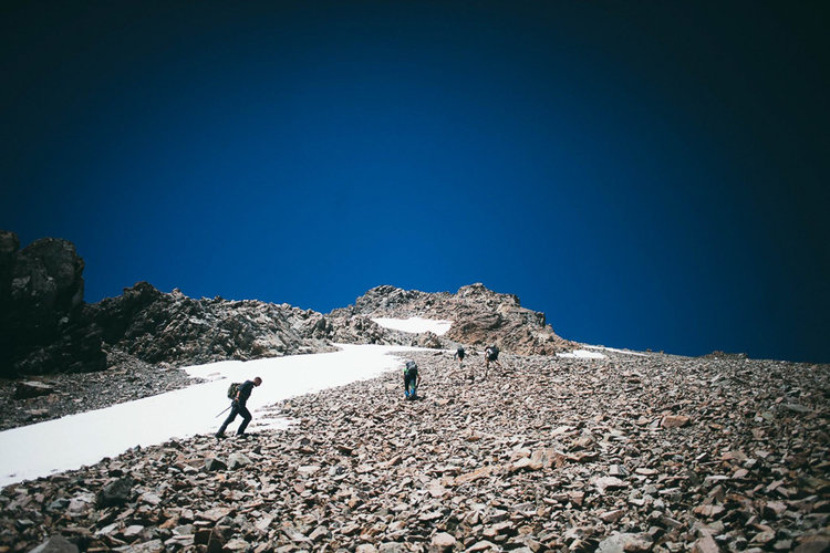 Approaching the summit. Rocky scree made a tricky climb. Photo: Tom Powell